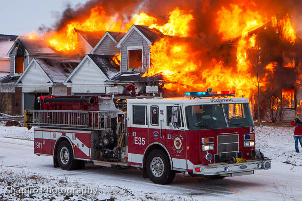 Woodstock FPD IL burning down a townhouse Pierce Saber big fire
