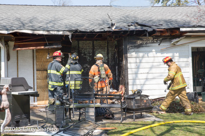 Northfield (IL)  firefighters at the scene of a house fire at 2050 Norfolk Road 3-26-16. Larry Shapiro photo